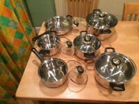 A brand new set of 5 saucepans with lids and a frying pan. Unwanted present