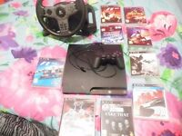 playstation 3 with hand controller and 9 games
