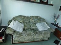 2 Seater Sofa Bed in Excellent condition with metal sprung frame and lifetime structural Guarantee