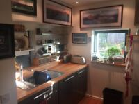 3 bedroom detached eco house with car port and garden in the 2010 Scottish Housing Expo development