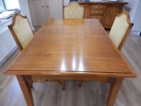 Dining table and 8 upholstered chairs.