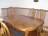 Very attractive dining table and 6 chairs