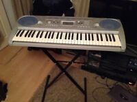 Yamaha keyboard with stand included in great condition.