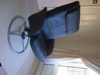 2 Black leather recliner chairs with silver base. Adjustable and comfortable.