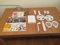 Wii console, 8 games, 2 controllers,golf club, 2 tennis rackets, baseball bat for sale