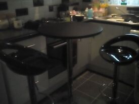 Black and chrome bistro table and 2 stools good for small kitchens.