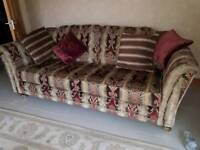 Two 3 seater sofas and foot stool