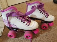 Girls rollerskates size 1 more 13 great condition