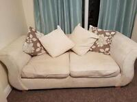 Cream two seater sofa for sale