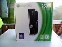 Xbox 360 250GB with HDMi cable and Play Charge Kit.