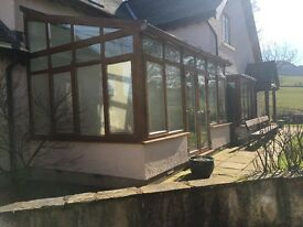 Used double glazed conservatory, glass roof, double french doors, fitted pleated blinds throughout.