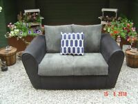 Small / Petite Black Two Seater Sofa. In Good Clean Condition. Can Deliver.