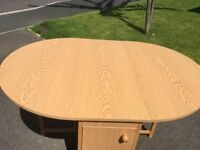 QUICK SALE !! Folding Dining table and 4 chairs with storage area for the chairs