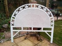 White wicker headboard for a double bed