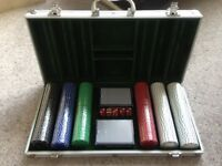 Playing cards and poker chips and dice set in carry case
