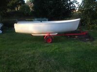 Fishing rowing boat with outboard