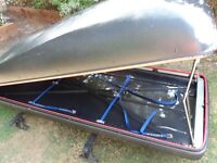 Car top box approx 7ft x 3ft with roof bars. Unable to lock due to no key but open and shuts fine