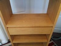 Bookcase solid wood in beech. From Next Home, perfect condition. Shelving with one middle drawer.