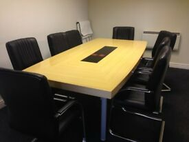 Boardroom Table and Chairs. 2.4m X 1.2m German brand 2 chairs slight ware. Table in Good condition.