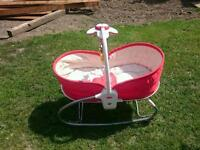 Rocking moses basket with lullaby mobile