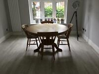 Pine table with matching chairs (4 shown in picture, 7 available)
