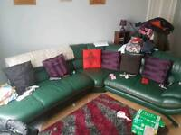 Large green corner sofa