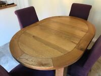 Solid Oak oval extending dining table with 6 chairs