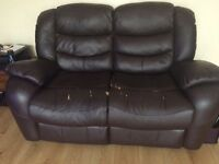 Brown two seater reclining leather sofa