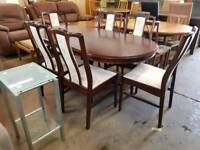 Stag extendable table with six cushioned chairs