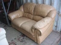 MODERN LIGHT TAN LEATHER 2 SEATER SOFA. IN GOOD ORDER. COMFORTABLE. VIEWING/DELIVERY AVAILABLE