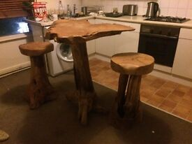 SOLID WOOD TABLE AND 2 STOOLS