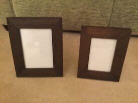 Photo frames in dark brown wood