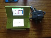 Green DS and charger with Call of Duty 4. Only used by adults.