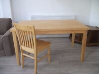 Dining table and four chairs (extra chairs available).