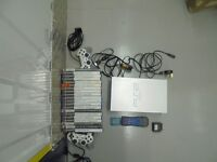 PS2 (silver) bundle with 2 controllers, 20 games and memory