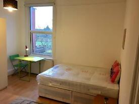 Lovely large bright and sunny fully self contained studio flat. Free WIFI. Available now!