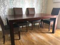 Dining room table and chairs and sideboard