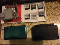 Nintendo 3ds with 6 games including mario kart 7