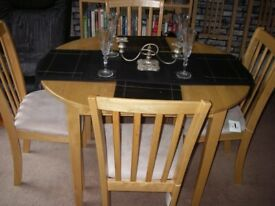 Light wood extendable dining table with 6 chairs