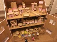 Wooden Dolls House with lots of wooden furniture and wooden dolls