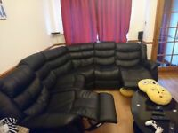 Reclining leather corner sofa