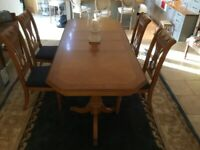 Wooden dining table, sideboard, corner cabinet and 10 chairs