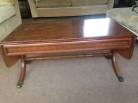 Beautiful Nathan coffee table. Has drop down sides that lift up to extend. Quality piece.