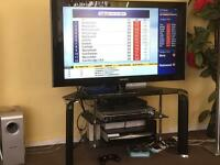 50 inch tv Samsung with black glass table