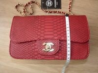Red Ladies Chanel alligator style.