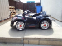 12v battery powered sit on car..