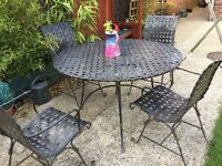heavy iron garden table and chairs