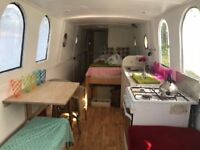 Unusual looking shabby chic open plan Narrowboat liveaboard houseboat