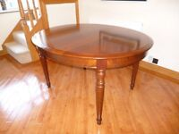 Oval shape mahogany extendable dining table