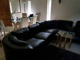 faux leather sofa chair and pouffe